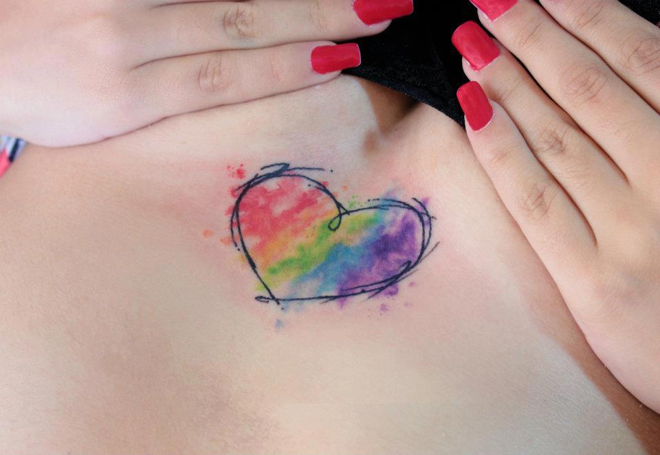 Girl Showing Her Watercolor Heart Tattoo