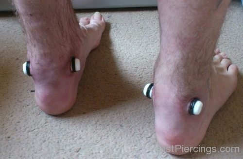 Man With Extreme Gauge Ankle Piercing