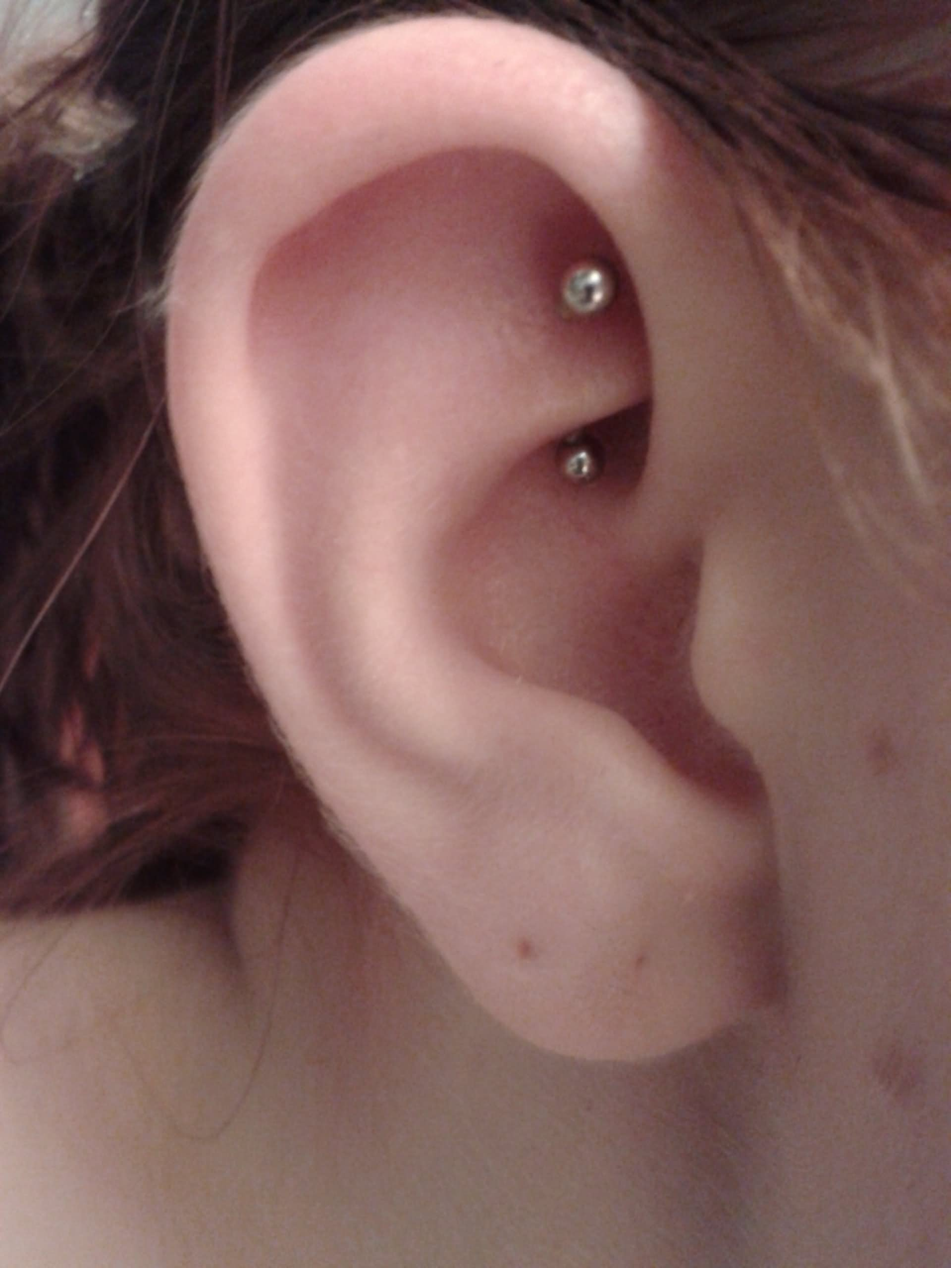 Rook Piercing With Curved Silver Barbell
