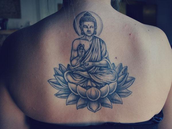 Amazing Buddha On Lotus Tattoo On Girl Upper Back