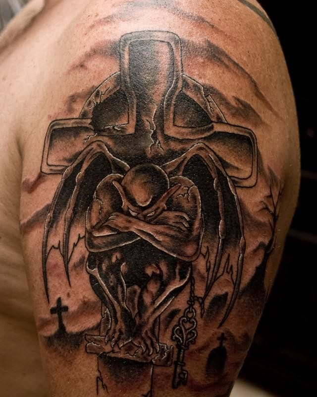 661764684 Black And Grey Gargoyle On Cross Tattoo On Man Left Shoulder