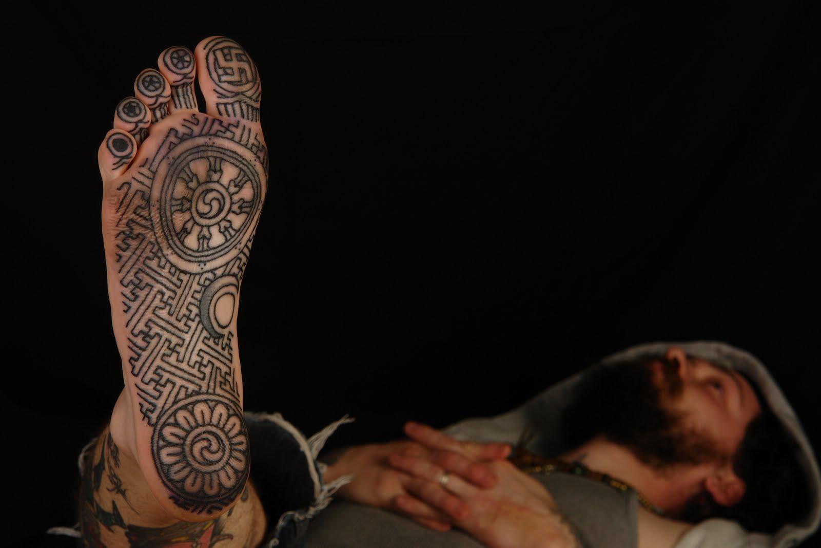 22 buddhist tattoo designs images and ideas black buddhist symbol tattoo on man right lower foot biocorpaavc Images