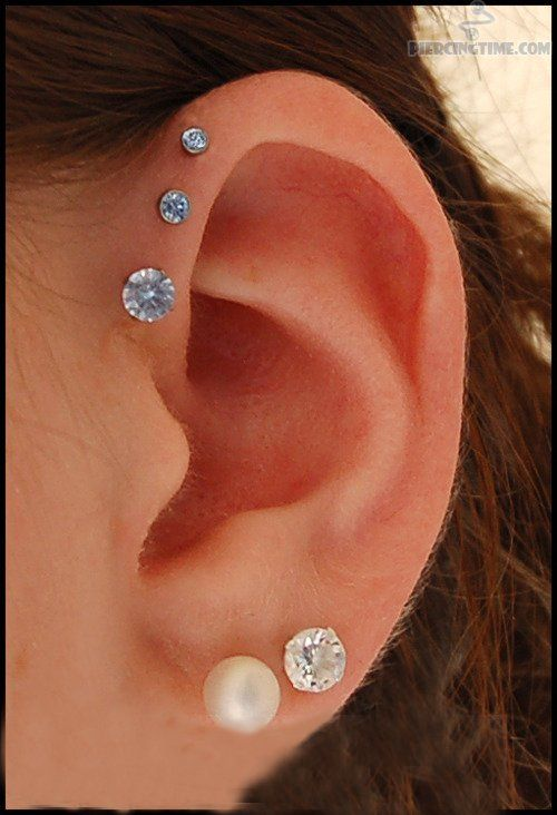 Dual Lobe And Triple Anti Helix Piercing Picture