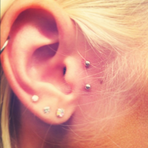 Triple Lobe And Vertical Tragus Piercing For Young Girls