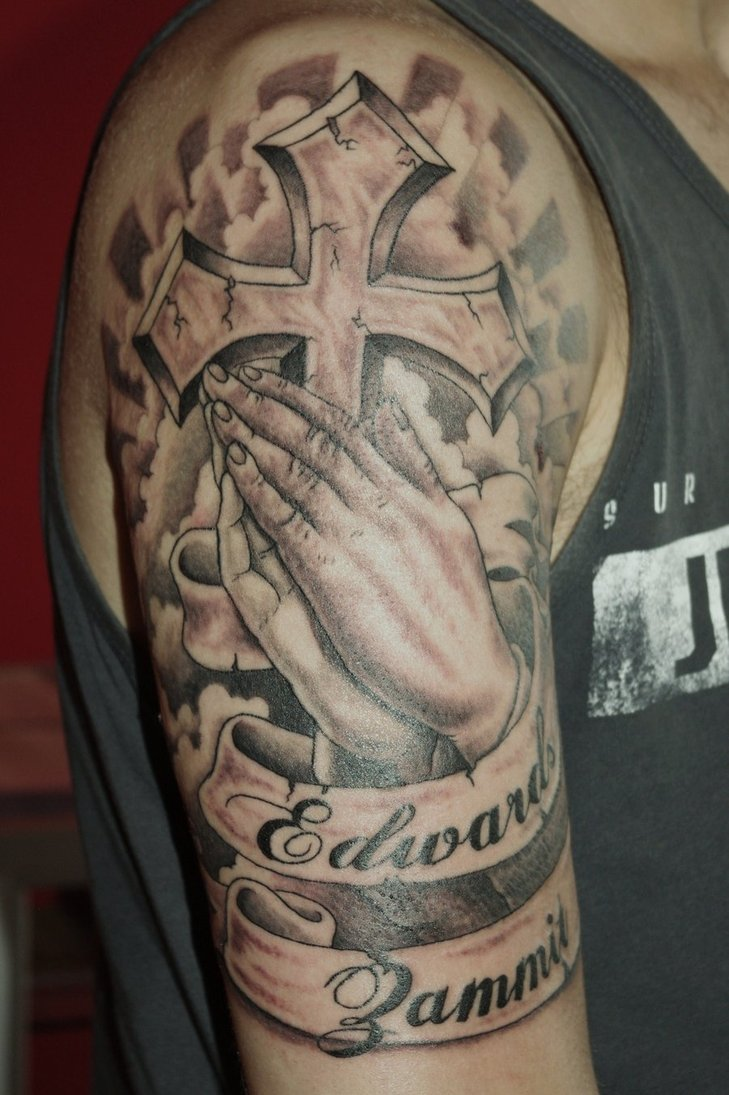bc6b8e8bba13b Black And Grey Cross In Praying Hands With Banner Tattoo On Half Sleeve