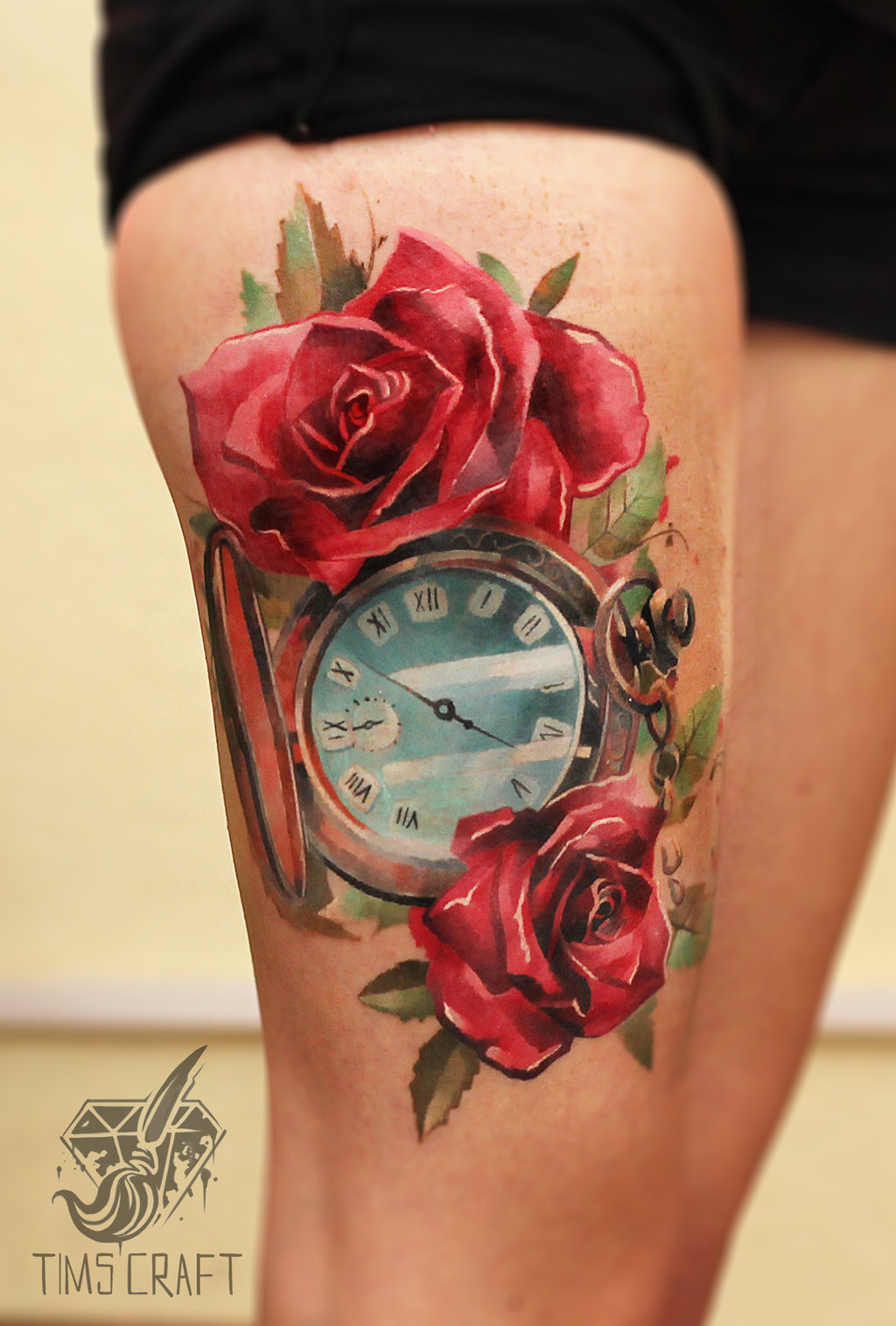 Black ink skull with roses and pocket watch tattoo on thigh for Pocket watches tattoos