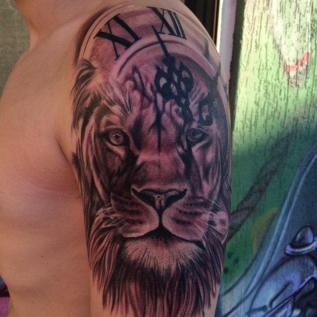 Black And Grey Lion Head With Clock Tattoo On Left Shoulder
