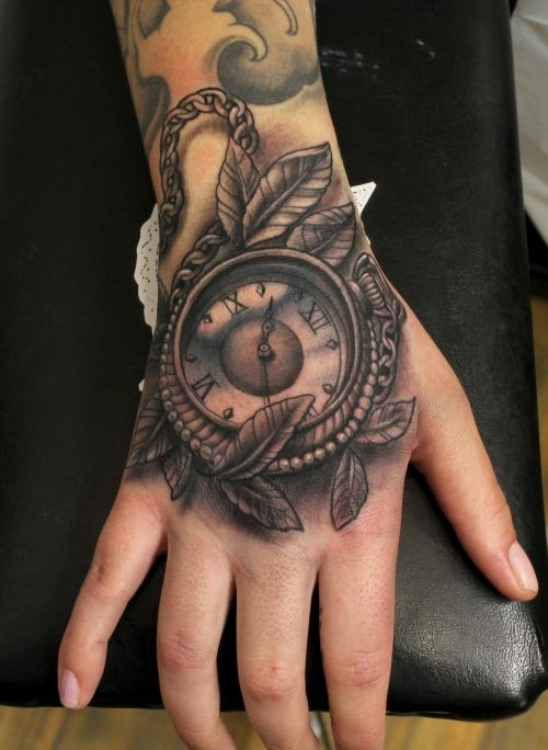 Black And Grey Pocket Watch With Leaves Tattoo On Hand By Ion