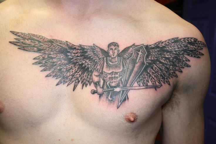 Black And Grey Warrior With Wings Tattoo On Man Chest