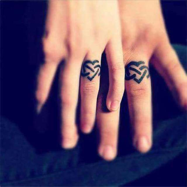 24 wedding tattoo ideas images and pictures for Wedding ring finger tattoos designs