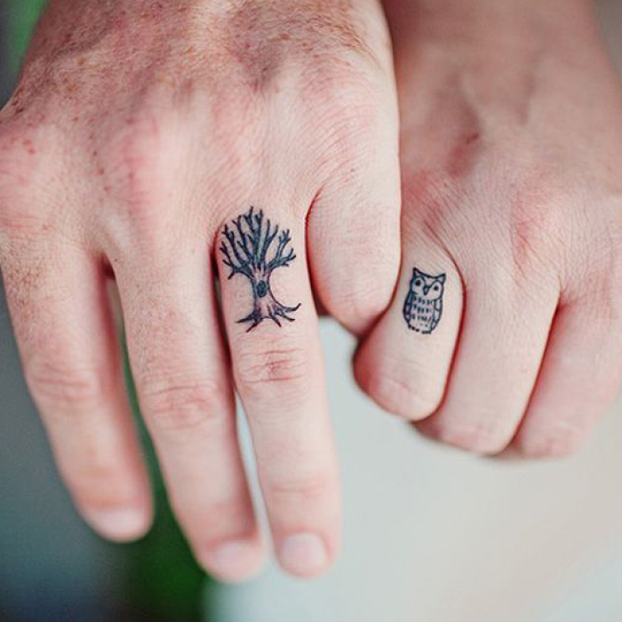 Black Owl And Tree Wedding Ring Tattoo On Couple Finger