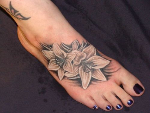 2b5907de4 White And Grey Lily Tattoo On Girl Right Foot