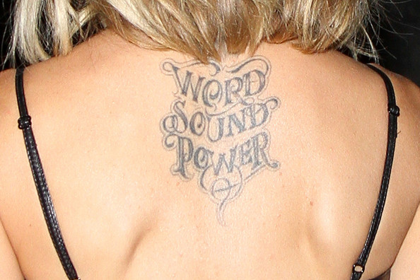 Grey Ink Word Sound Power Lettering Tattoo On Girl Upper Back
