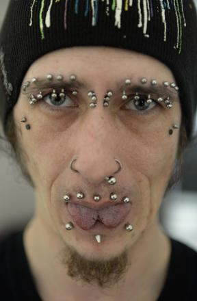 Multiple facial piercings