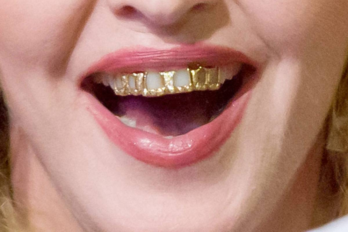 Unique Tooth Piercing With Gold Jewellery