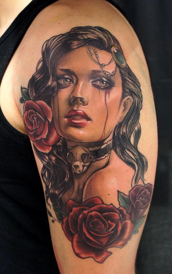 Women face with two roses tattoo on shoulder by betty for Two faced tattoo