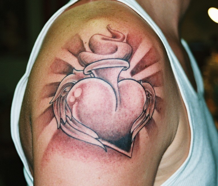 Black And Grey Sacred Heart With Angel Wings Tattoo On Right Shoulder