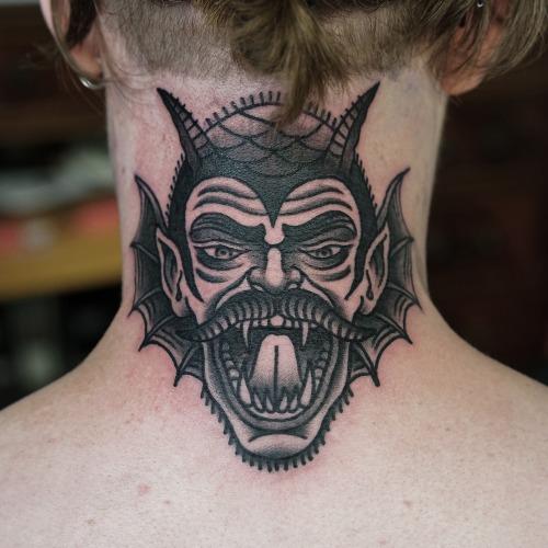 black angel and devil girl tattoo on girl back neck