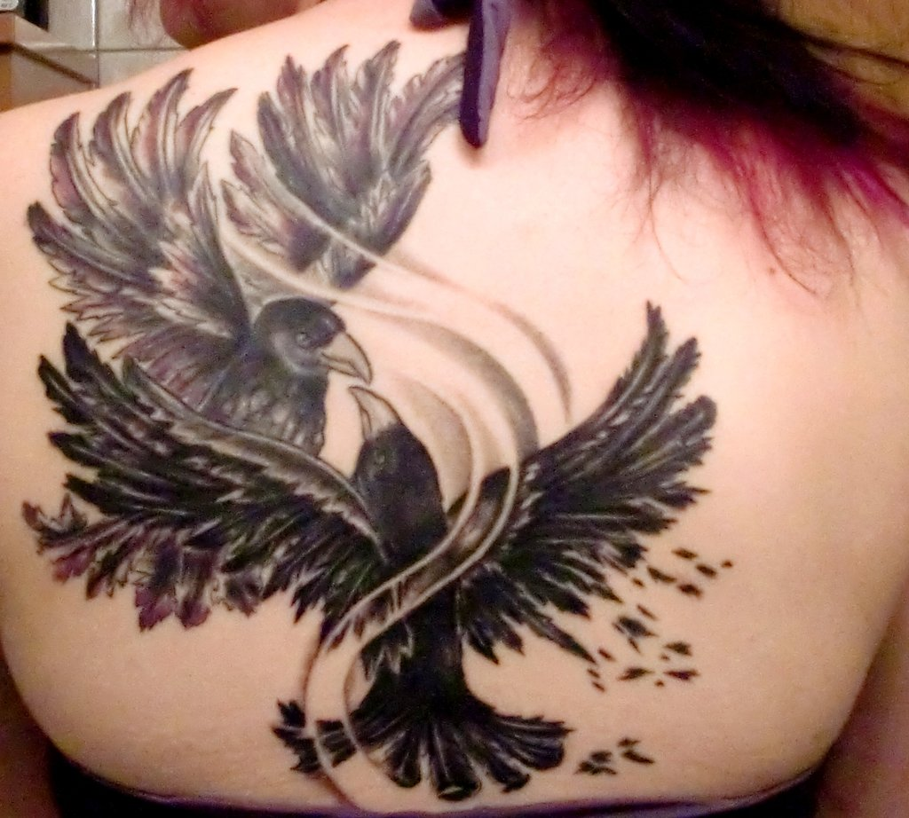 black ink two crows fighting tattoo on girl upper back. Black Bedroom Furniture Sets. Home Design Ideas