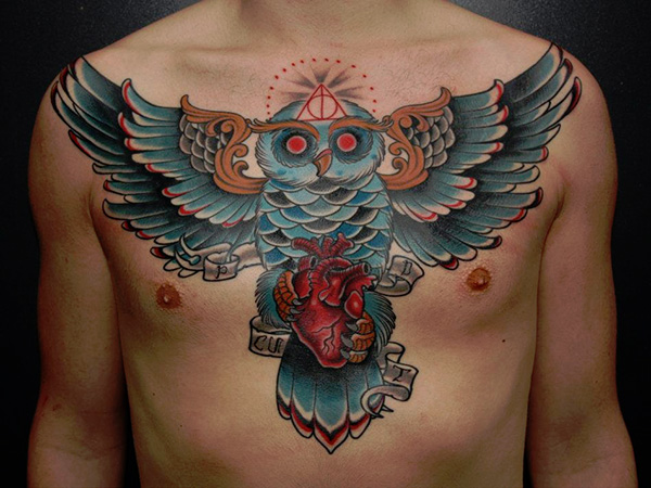 Wicked Owl With Heart In Claws Tattoo On Man Chest