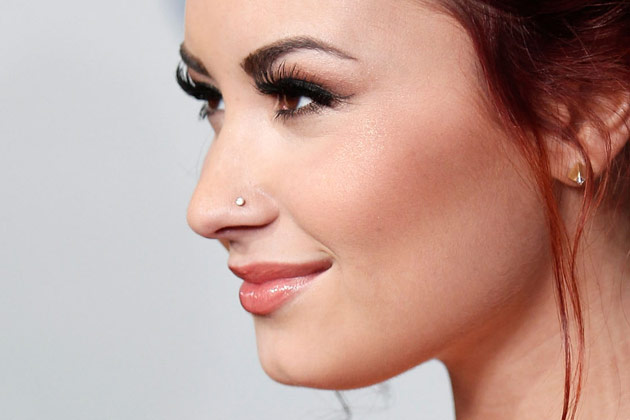 Left Ear Lobe And Nostril Piercing Idea