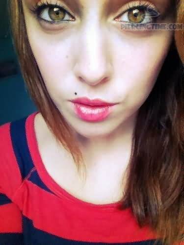 Madonna Piercing With Small Black Stud