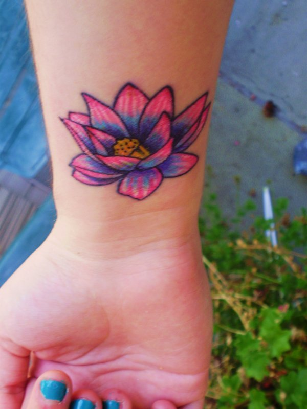 Colorful lotus flower tattoo on girl wrist pink and blue lotus flower tattoo on girl wrist mightylinksfo Images
