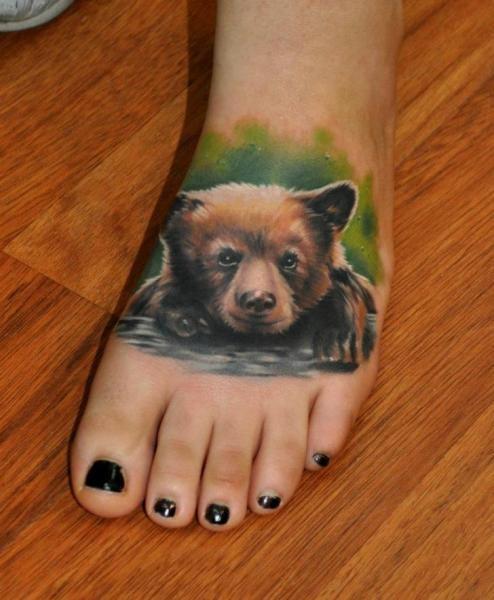 Amazing bear cub tattoo on girl foot for Bear cub tattoo