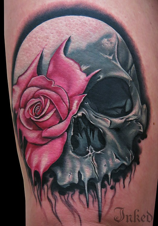 Beautiful pink rose tattoo on bicep for Rose and skull tattoos
