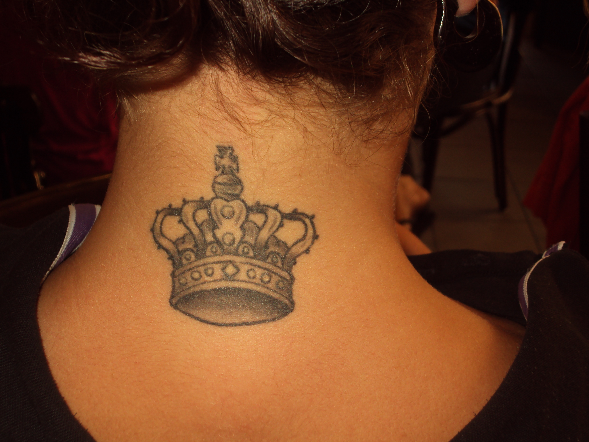 Black And Grey Queen Crown Tattoo On Girl Back Neck
