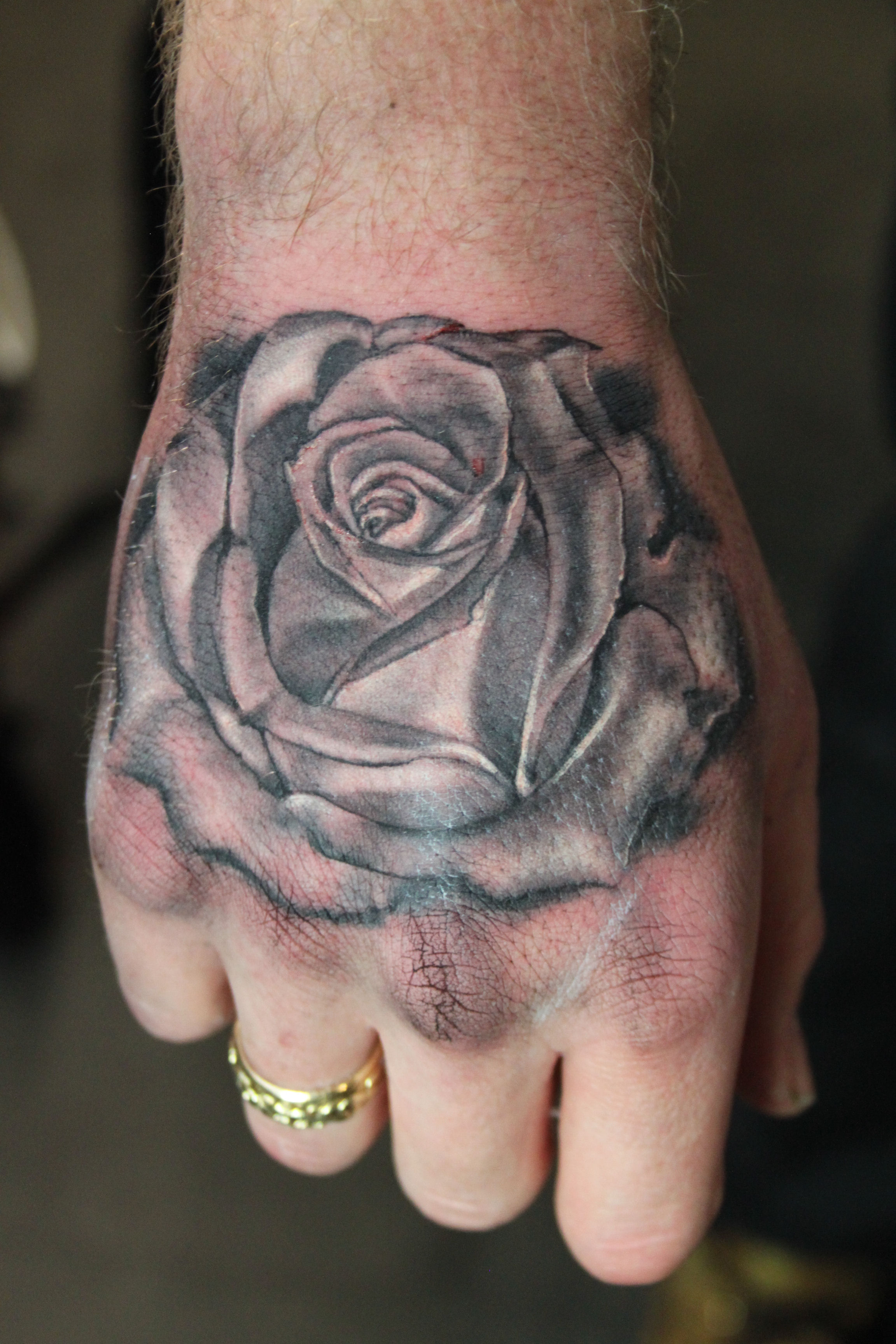 Black And Grey Rose Tattoo On Hand