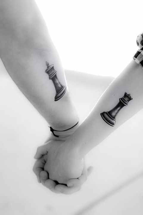 Black Ink King And Queen Chess Pieces Tattoo On Couple Forearm