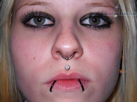 Girl Have Septum Medusa And Lower Lip Dolphin Bites Piercing