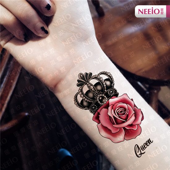 Queen - Red Rose With Queen Crown Tattoo On Girl Wrist