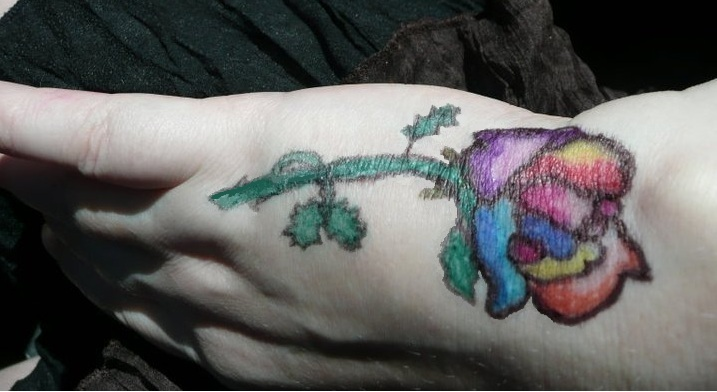 Awesome Rainbow Color Rose Tattoo On Hand