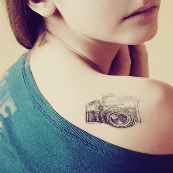 5423655c40599 Black And Grey Camera Tattoo On Girl Right Back Shoulder