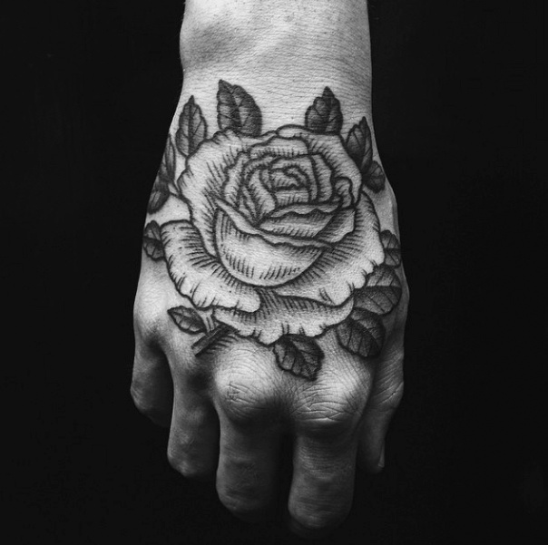 Black and white rose tattoo on hand mightylinksfo Image collections