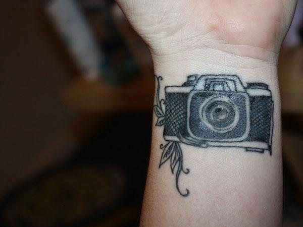 Black Camera Tattoo On Wrist