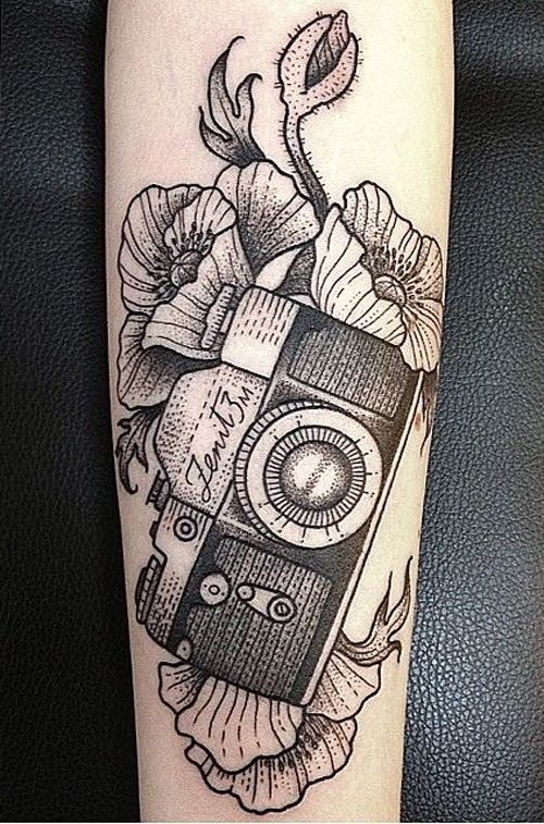 12477f2d98a1e Black Ink Camera With Flowers Tattoo Design For Forearm