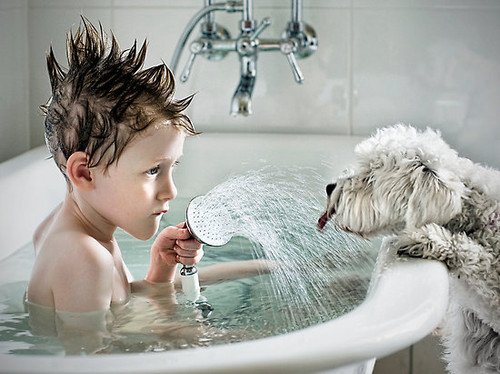 Funny Kid And Cat Taking Shower
