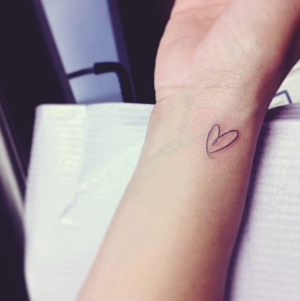 23 simple heart tattoo images pictures and designs for Small heart tattoos on wrist