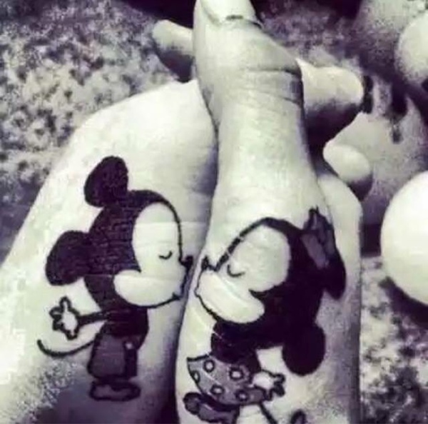 Black Ink Disney Mickey And Minnie Mouse Tattoo On Both Hand