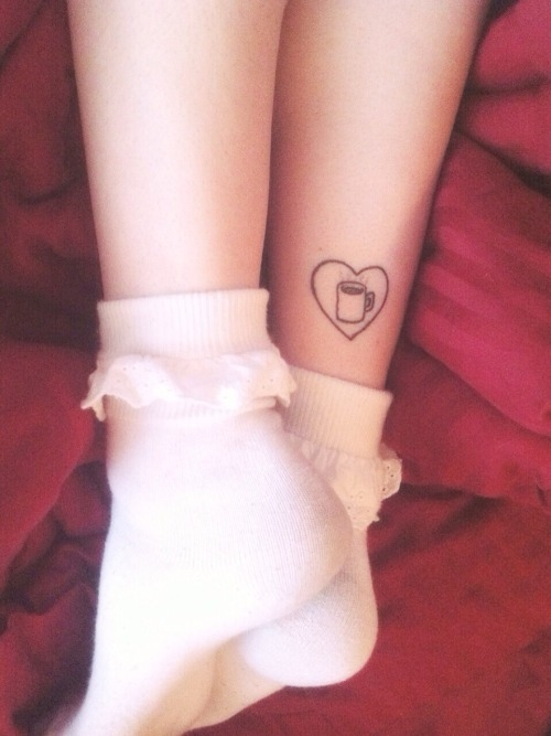 Black Outline Coffee Cup In Heart Tattoo On Leg