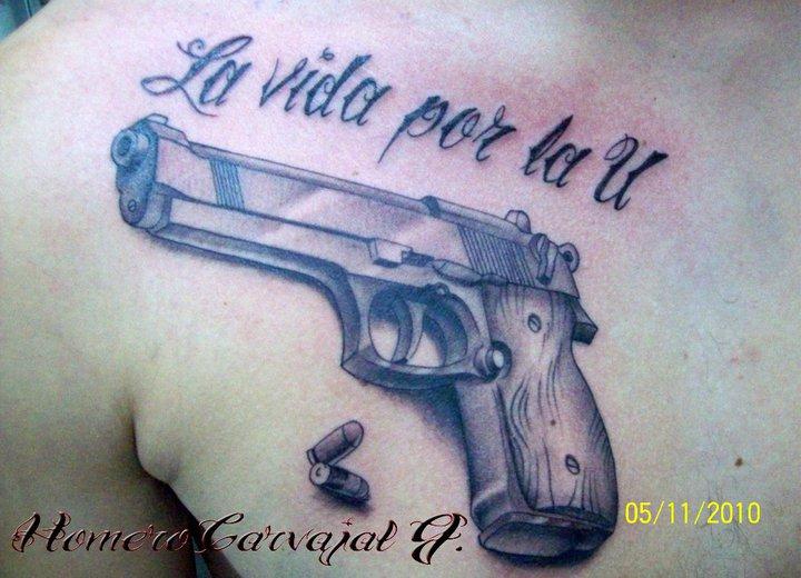 e3250639d La Vida Por La U - 3D Gun With Bullets Tattoo On Man Chest