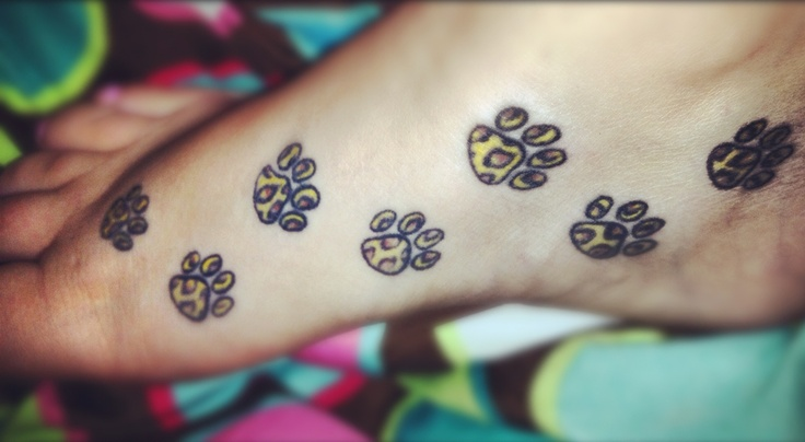 19 Leopard Paw Prints Tattoo Designs, Images And Pictures