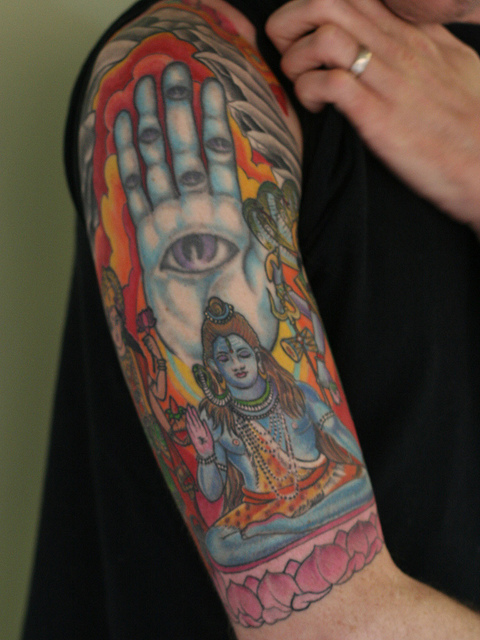 awesome colorful lord shiva tattoo on right half sleeve by kenn wilson. Black Bedroom Furniture Sets. Home Design Ideas