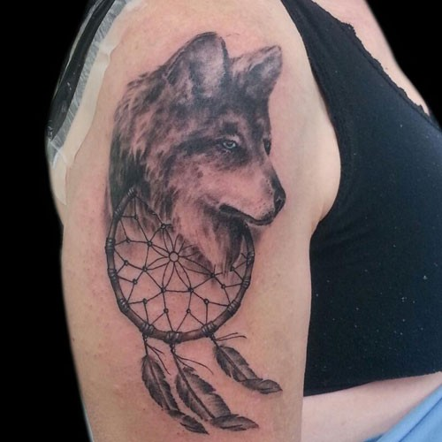 40 Dreamcatcher Wolf Tattoo Designs Images And Pictures Adorable Dream Catcher Tattoo For Guys