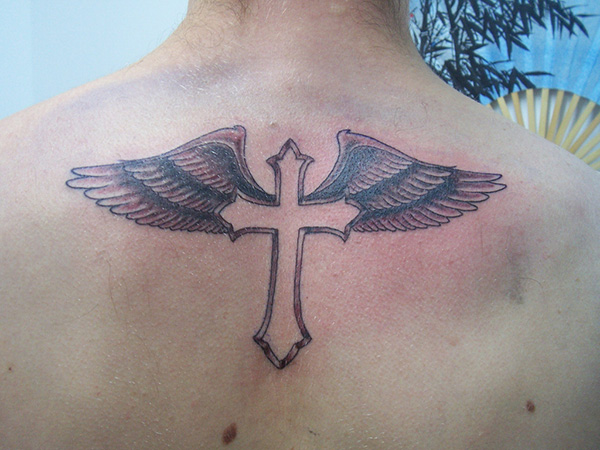 a30d486d6 Black Ink Cross With Wings Tattoo On Upper Back