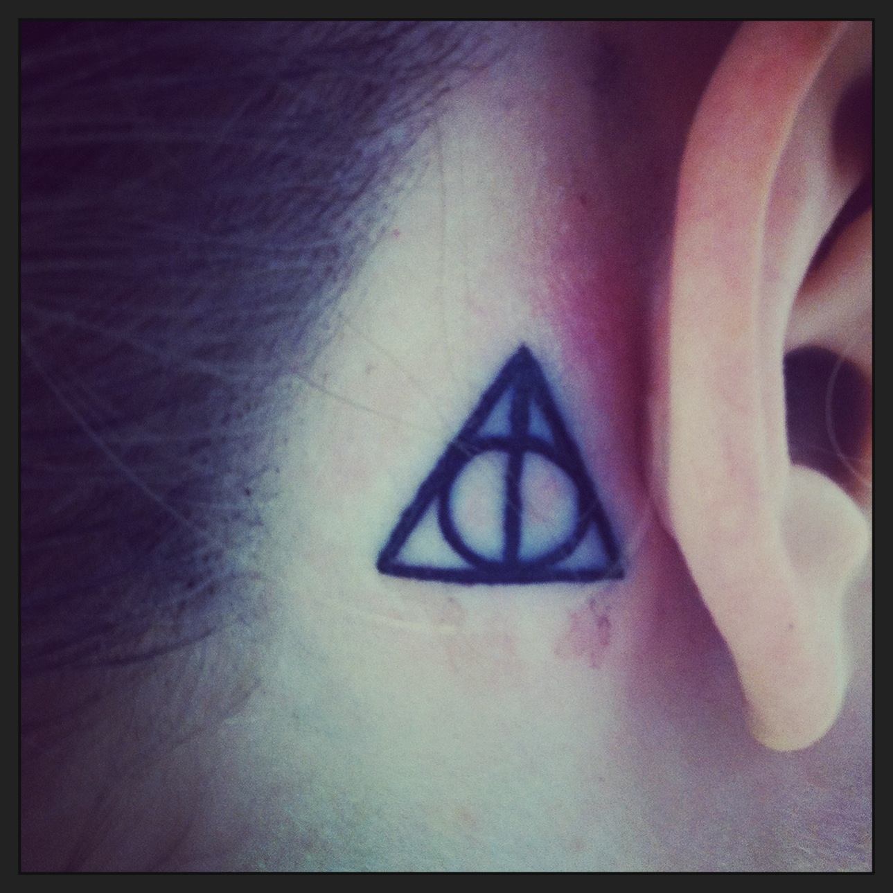 25 harry potter tattoo images pictures and design ideas harry potter deathly hallows symbol tattoo on girl behind the ear buycottarizona