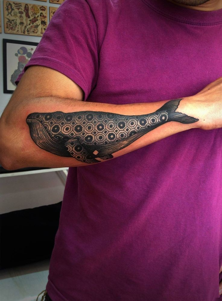 Black ink whale skeleton tattoo on left arm for Unique arm tattoos